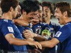 pemain-timnas-jepang-bersuka-cita-usai-timnya-menang-atas-uzbekistan.jpg
