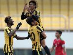 pemain-timnas-u-19-malaysia-merayakan-gol-ke-gawang-indonesia_20180710_225204.jpg