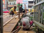 pembangunan-jembatan-di-atas-sungai-veteran-banjarmasin-provinsi-kalsel-sabtu-06032021-123.jpg