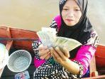 penerima-manfaat-program-keluarga-harapan-pkh_20171102_114738.jpg