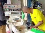 penjual-beras-di-kota-banjarbaru-provinsi-kalimantan-selatan-kamis-2392021.jpg