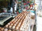 penjual-telur-ayam-di-jalan-kemuning-banjarbaru-kalsel-senin-14062021.jpg