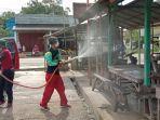penyemprotan-disinfektan-di-tempat-umum-di-wilayah-kelurahan-jangkung-kecamatan-tanjung-kalsel.jpg