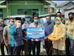 penyerahan-bantuan-kepada-kelompok-nelayan-oleh-bupati-tanbu.jpg