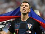 penyerang-kroasia-mario-mandzukic-merayakan-kemenangan-timnya-2-1-atas-inggris_20180712_060937.jpg