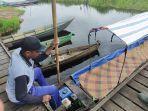 perahu-bermotor-di-objek-wisata-susur-rawa-di-desa-pulantani-kecamatan-haur-gading.jpg