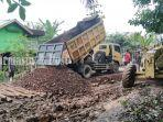 perbaikan-jalan-nasional-desa-sungai-gampa-asahi-kabupaten-batola-kalsel-minggu-14032021.jpg