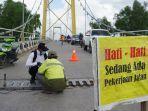 perbaikan-oprit-jembatan-barito.jpg