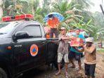 personel-bpbd-kabupaten-banjar-salurkan-bantuan-untuk-korban-longsor-di-desa-sungai-langsat.jpg