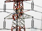 petugas-di-bagian-tinggi-dari-menara-listrik-25052021.jpg
