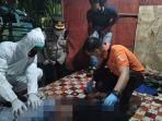 petugas-evakuasi-jenazah-warga-nganjuk-di-pondok-sopir-lintas-nusantara-banjarbaru-03042021.jpg