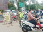 petugas-gabungan-di-kabupaten-hst-kalsel-melaksanakan-operasi-yustisi-30082021.jpg