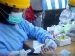 petugas-medis-melakukan-rapid-test-di-pasar-lama-banjarmasin.jpg