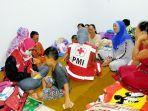 pmi-banjar-memberikan-layanan-kesehatan-terhadap-lansia-pasca-bencana-banjir.jpg