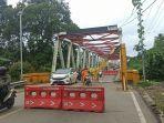portal-jembatan-paringin-mengalami-kerusakan-pasca-ditabrak-truk.jpg