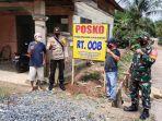 posko-relawan-covid-19-tingkat-rt-di-desa-lokpaikat-kabupaten-tapin-kalsel-sabtu-13022021.jpg