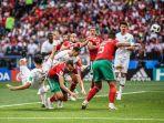 prediksi-skor-portugal-vs-iran-di-grup-b-piala-dunia-2018_20180625_145004.jpg