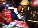 relawan-luka-kena-seng-di-desa-pematang-panjang-sungai-tabuk-kalsel-minggu-04072021.jpg