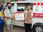 rsud-sultan-suriansyah-banjarmasin-menerima-bantuan-mobil-ambulans-senin-07122020.jpg