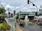 ruas-jalan-yang-tak-lagi-terendam-di-barabai-kabupaten-hst-provinsi-kalsel-sabtu-16012021.jpg