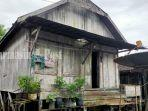 rumah-banjar-tempat-latihan-kuntau-di-kampung-bawah-sau-kabupaten-tala-kalsel.jpg