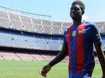 samuel-umtiti-diperkenalkan-sebagai-pemain-baru-barcelona_20180203_054122.jpg