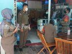 satpol-pp-sosialisasi-imbauan-3m-di-cempaka-banjarbaru-provinsi-kalsel-sabtu-05122020.jpg