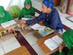 sejumlah-anak-tengah-belajar-mengaji-di-masjid-at-taqwa-banjarmasin.jpg