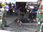 seorang-pengunjung-pasar-antasari-banjarmasin-dihukum-push-up.jpg