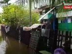 situasi-banjir-di-desa-jawa-laut-kabupaten-banjar-provinsi-kalsel-minggu-1012021.jpg