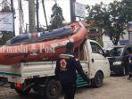 sukarelawan-pmi-banjarmasin-pmi-kalsel-evakuasi-korban-banjir-handil-bakti-batola-18012021.jpg