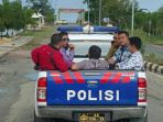 susi-pudjiastuti-naik-mobil-polisi-kap-terbuka_20170321_125805.jpg