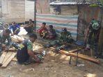 tentara-manunggal-membangun-desa-tmmd-2018-di-kabupaten-tapin_20180712_094612.jpg