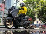 tips-berkendara-sepeda-motor-saat-hujan.jpg