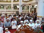 ummat-muslim-kapuas-tengah-berdoa-usai-melaksanakan-salat-gerhana-bulan_20180131_233632.jpg
