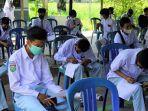 vaksinasi-covid-19-untuk-pelajar-di-sma-negeri-1-angkinang1.jpg