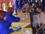 vaksinasi-di-kantor-kelurahan-jambu-hilir-kandangan-kabupaten-hss-kalsel-kamis-21102021.jpg