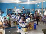 vaksinasi-dosis-kedua-dilaksanakan-di-aula-dpmd-kapuas-kamis-842021-sfasdf.jpg