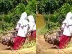 viral-anak-sekolah-seberangi-sungai-ke-sekolah-dengan-bergelantungan-menyeberangi-sungai.jpg