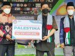 wabup-tanbu-hm-rusli-serahkan-bantuan-bagi-palestina-melalui-mri-act-jumat-25062021.jpg