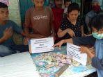 warga-relawan-dan-simpatisan-melakukan-aksi-mengggalang-dana-untuk-2bhd.jpg