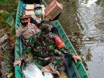 warga-terdampak-banjir-desa-mantaas-kecamatan-labuan-amas-utara-kabupaten-hst-27012021.jpg