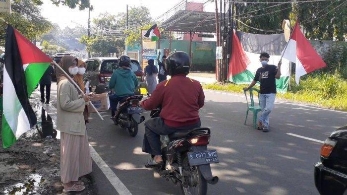 Belasan Remaja Tangsel Gelar Aksi Solidaritas, Turun ke Jalan Kibarkan Bendera Indonesia & Palestina
