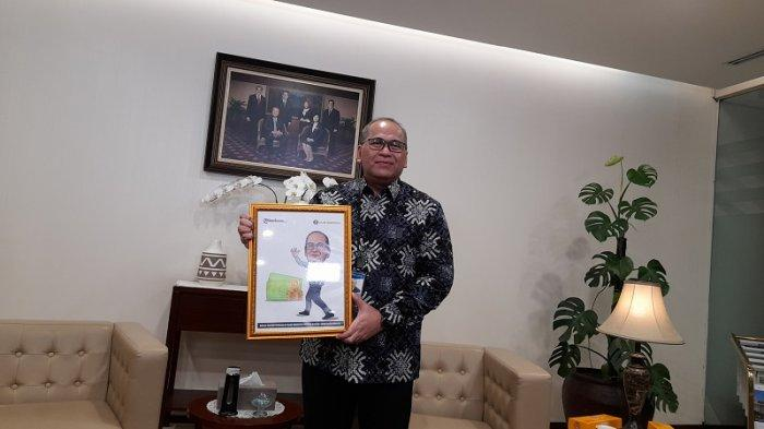 Mengenal Sosok Erwin Soeriadimadja, Kepala Perwakilan BI Banten yang Hobi Olahraga