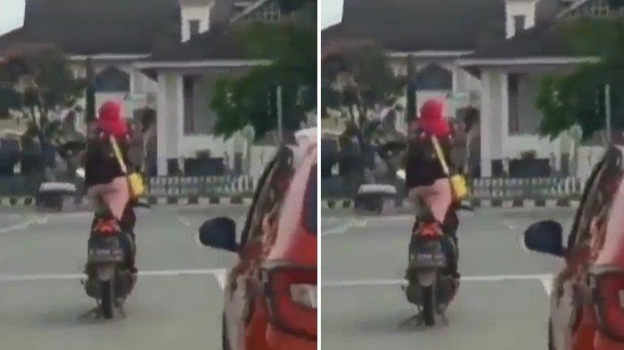 Viral Video Emak-emak Asik Berjoget di Atas Motor saat Lampu Merah, Warganet : 'Hoyong Viral Kitu?'