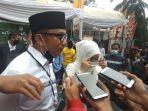 irna-narulita-dan-tanto-warsono-arba-telah-mendaftarkan-diri-ke-kpu-kabupaten-pandeglang.jpg