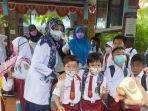 pembelajaran-tatap-muka-ptm-pada-hari-pertama-saat-pandemi-covid-di-sd-1-rangkasbitung.jpg