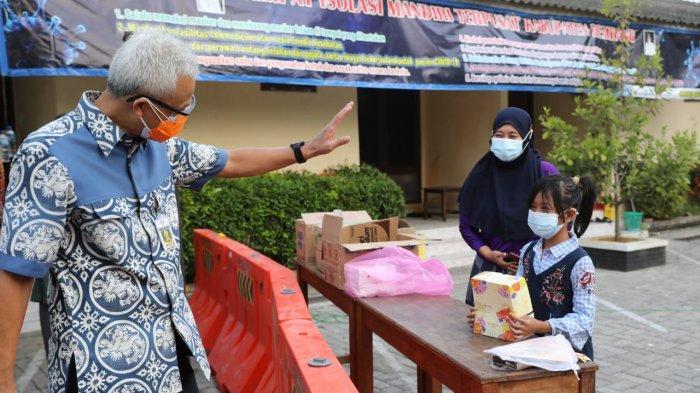 Ajudan Ganjar Ngos-ngosan Cari Cokelat di Rembang, Hadiah Buat Siswi Kelas IV SD
