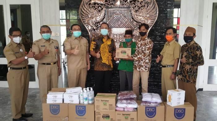 Peduli Kesehatan Warga, GP Ansor Kota Semarang Sumbang Vitamin dan Masker Lewat Pemkot