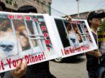 aktivis-di-china-melakukan-protes-atas-konsumsi-daging-anjing-di-negara-tersebut.jpg